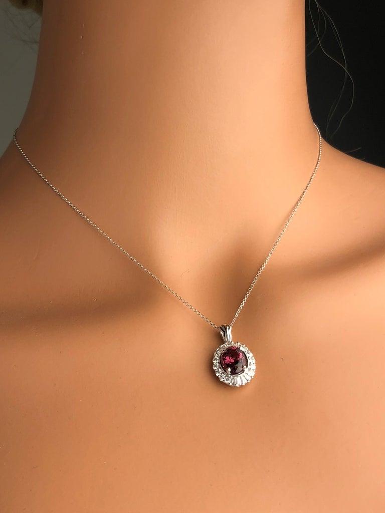 Contemporary 1.89 Carat Oval Cut Raspberry Garnet and Diamond Halo Pendant in 18 Karat Gold For Sale