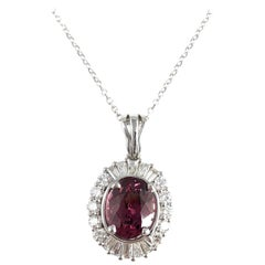 1.89 Carat Oval Cut Raspberry Garnet and Diamond Halo Pendant in 18 Karat Gold