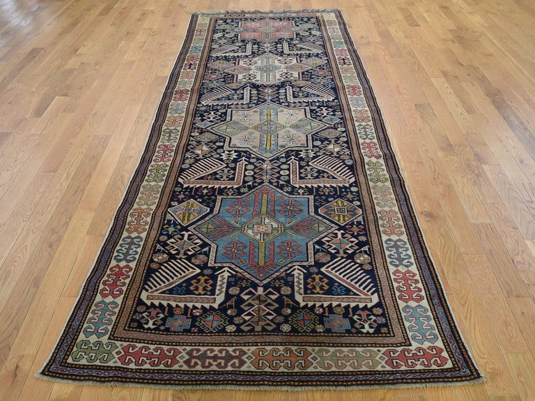 This is a genuine hand knotted oriental rug. It is not hand tufted or machine made rug. Our entire inventory is made of either hand knotted or handwoven rugs.  Bring life to your home with this lovely hand knotted Blue Akstafa Design, is an