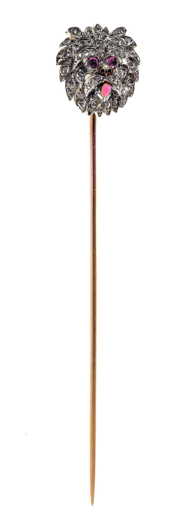 Naturalistically modelled stickpin of a dog of outstanding quality, possibly a Yorckshire Terrier. The lovely animal has with ruby eyes, a golden snout and a pink enamelled tongue. It's head is set with rose diamonds mounted in platinum, the
