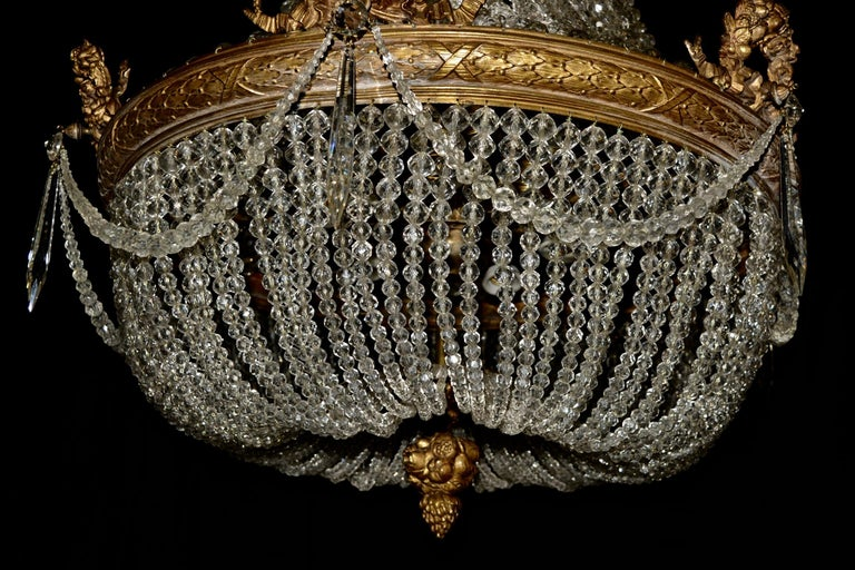 This beaded Empire basket chandelier has 15 lights. All the beads are made of genuine crystal and the drops are made of original Bohemia crystal. Chandelier has been restored but we have maintained the original shape and integrity of the late 19th