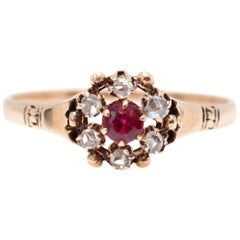 1890s 0.33 Carat Diamond Halo and Ruby Floral 9 Karat Gold Ring