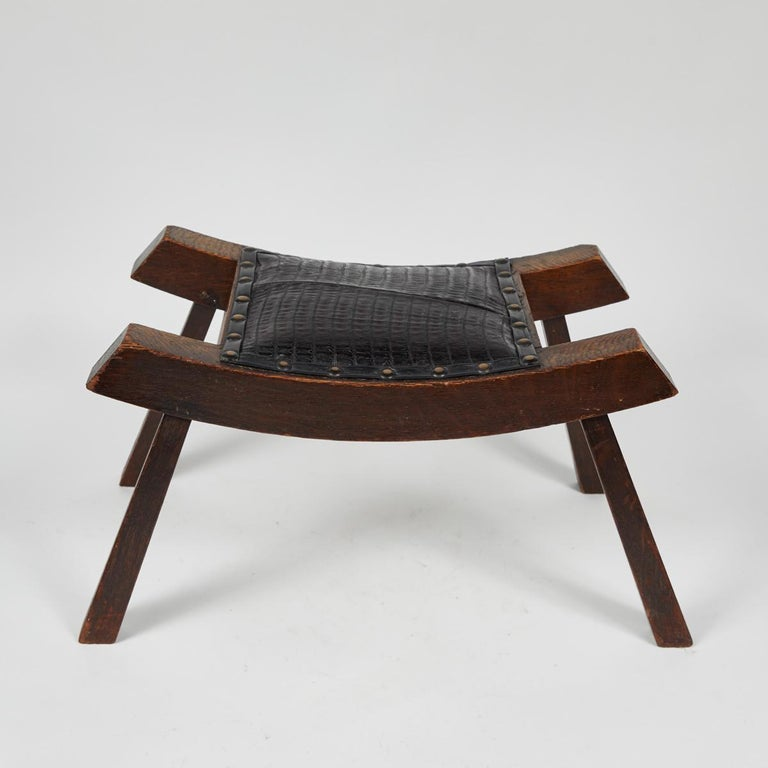 1890s English foot stool with upholstered black leather and studded trim.