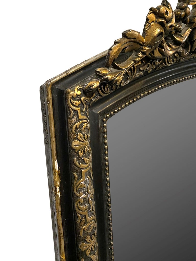 Late 19th Century 1890s French Cherub Motif Mirror Gesso and Hand Carved Gilt and Black Wood For Sale