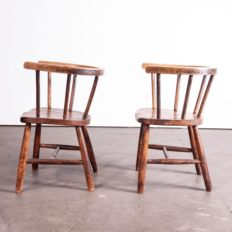 1890s pair of Victorian vintage child's chairs. Simple original Windsor style children's chairs made from dark stained Ash with steam bent backs. Seat height 30cm.  Workshop report: All of our vintage products show the rich beauty and history