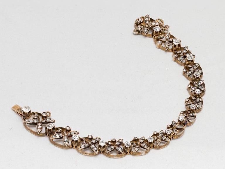 1890s Victorian Diamonds, Silver in Gold Graduated Bracelet with Floral Motifs In Good Condition For Sale In Miami, FL