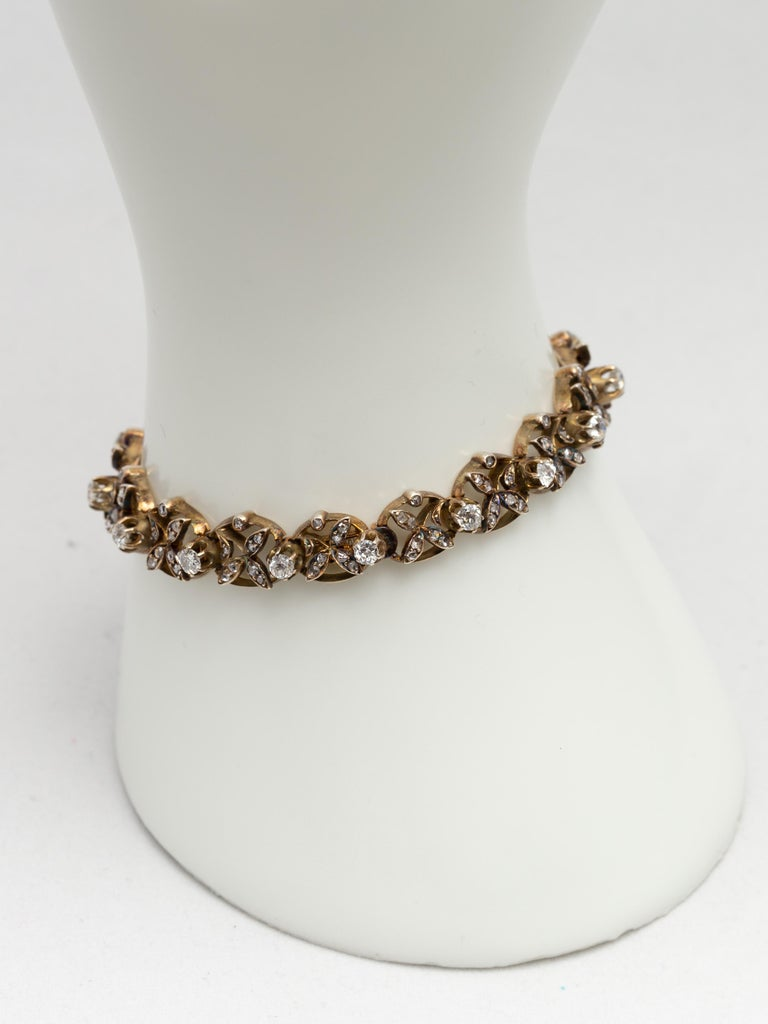 Women's 1890s Victorian Diamonds, Silver in Gold Graduated Bracelet with Floral Motifs For Sale