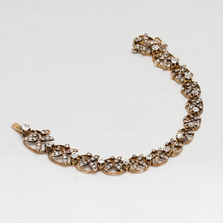 1890s Victorian Diamonds, Silver in Gold Graduated Bracelet with Floral Motifs For Sale 1