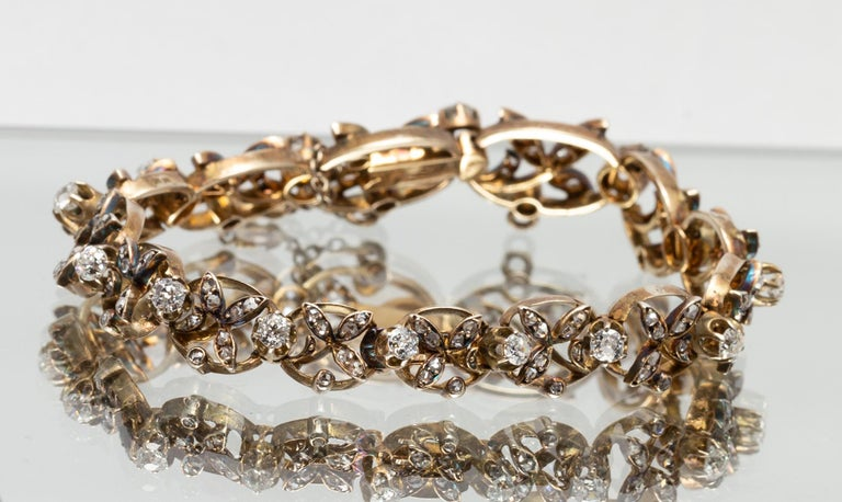 1890s Victorian Diamonds, Silver in Gold Graduated Bracelet with Floral Motifs For Sale 2