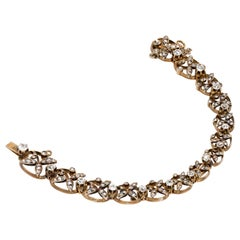 1890s Victorian Diamonds, Silver in Gold Graduated Bracelet with Floral Motifs