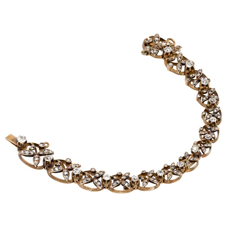 1890s Victorian Diamonds, Silver in Gold Graduated Bracelet with Floral Motifs For Sale
