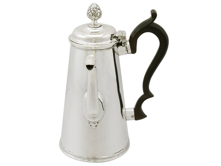 An exceptional, fine and impressive antique Victorian English sterling silver coffee pot; an addition to our silver teaware collection  This exceptional antique sterling silver coffee pot has a plain tapering cylindrical form with a moulded base,