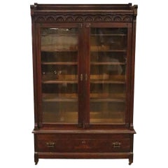 1890s Victorian Walnut Bookcase with Five Adjustable Shelves and Glass Doors