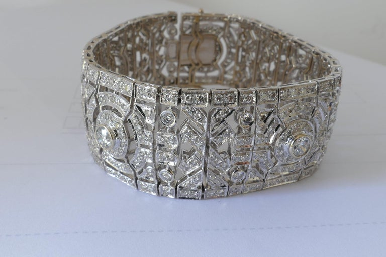 This superb Bracelet featuring G/H Colour Diamonds, SI1 Clarity is made up with just over 10 Carats of very good Diamonds. All together it has 449 Diamonds and measures 18.5cm in wrist size and 25mm wide. It features a box closure with a figure 8