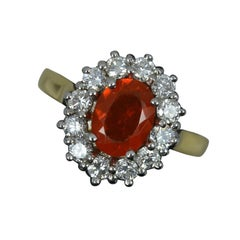 18ct Gold 0.78ct Fire Opal and 0.74ct Diamond Cluster Ring