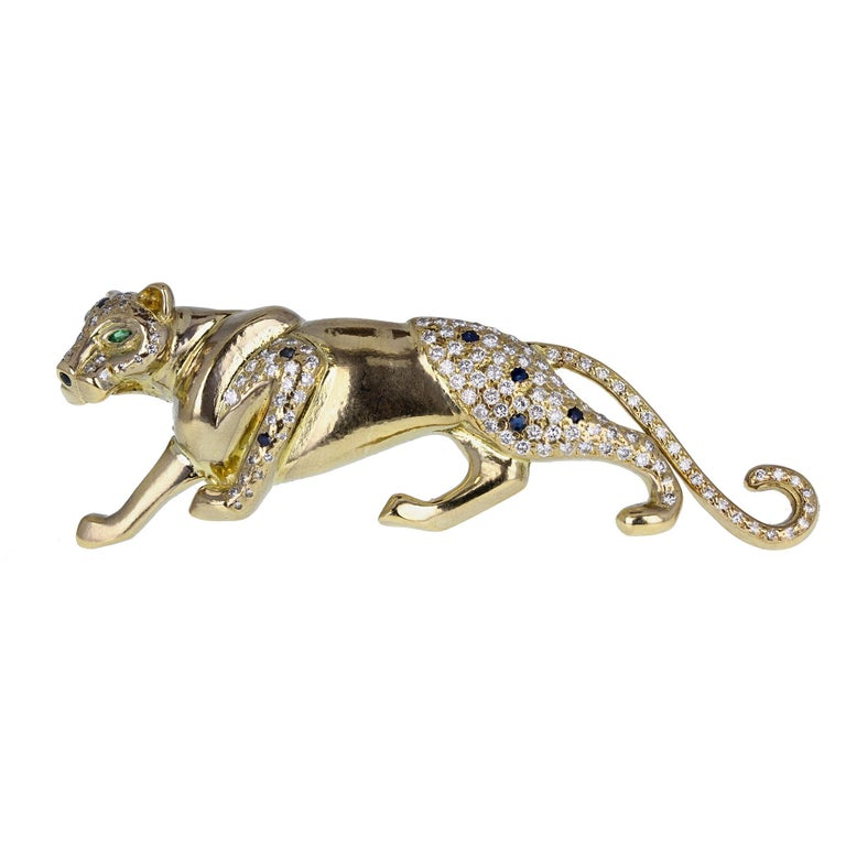 Modern 18 Carat Gold Diamond Sapphire Prowling Panther Brooch For Sale