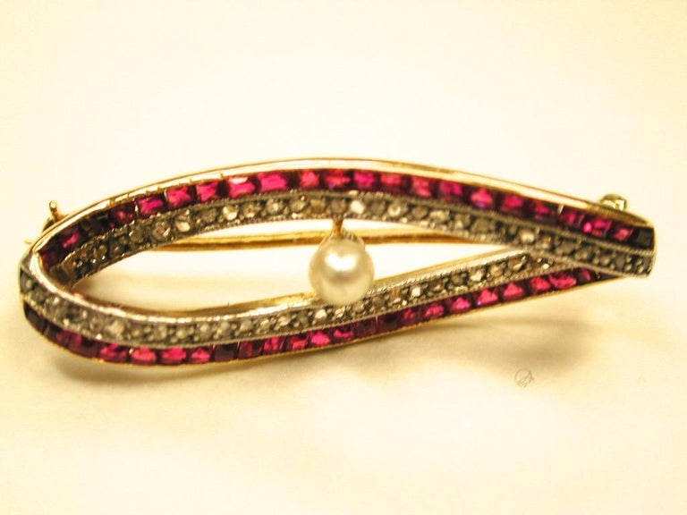 Women's 18 Carat Gold Ruby and Diamond Brooch Set with Centre Pearl, Dated circa 1920 For Sale