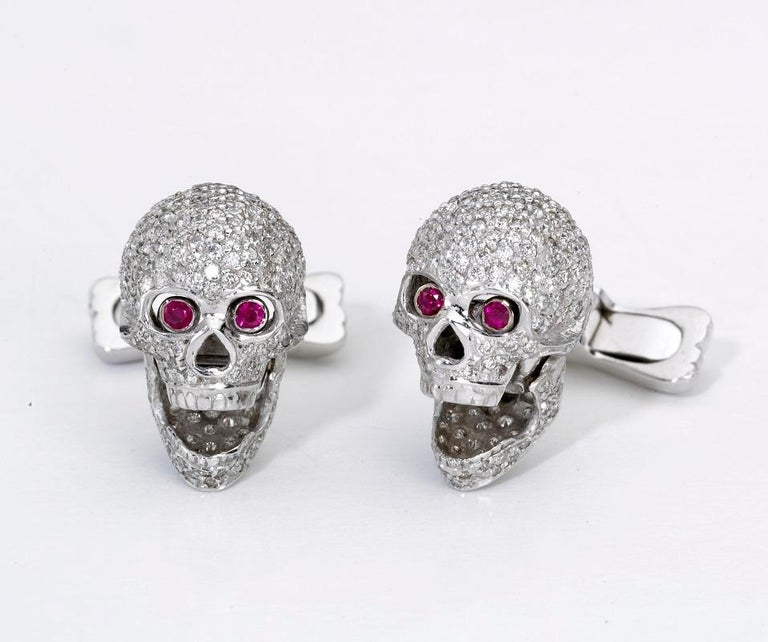 Contemporary 18 Carat White Gold Pave Diamond Skull Cufflinks with Ruby Eyes For Sale