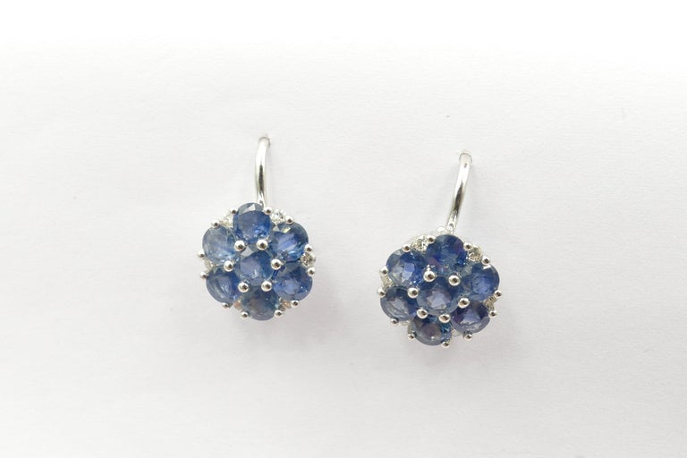 Beautiful Earrings that can be worn with any colour, day or night. They feature 14 sapphires of mid to medium dark colour, total weight 3.75 carats, Round Cut, Shared Claw Set, along with 14 Round Brilliant Cut Diamonds Colour H-K. The Earrings