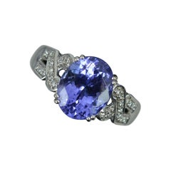 18ct White Gold Tanzanite and Diamond Engagement Cluster Ring