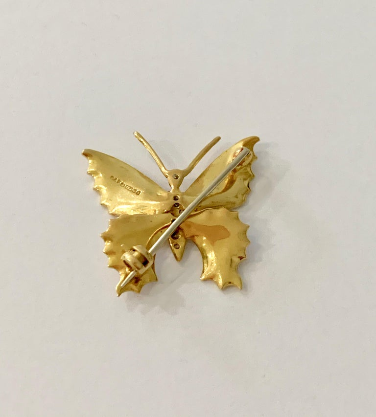 This is such a pretty and delicate gold and white enamel brooch, it would look elegant worn by anyone of any age.   The brooch is made of 18ct Yellow Gold and has off white enamel set on all four wings.  The body of the butterfly is set with 6 round