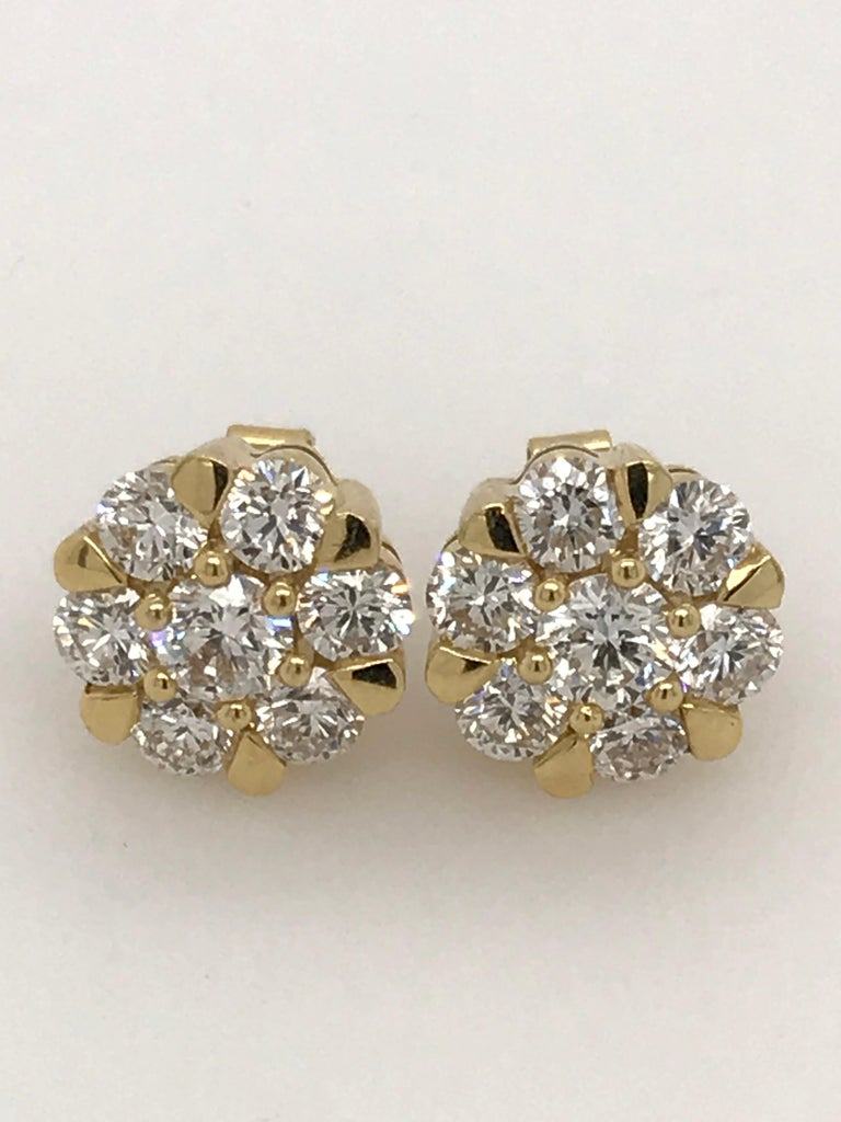 Diamond earrings with 2.00ct HSI brilliant cut diamonds set in 18ct yellow gold. The earrings are post and butterfly. The post extends from the back centre and they measure approximately 10mm across. 14 brilliant cut diamonds totalling 2.00ct There