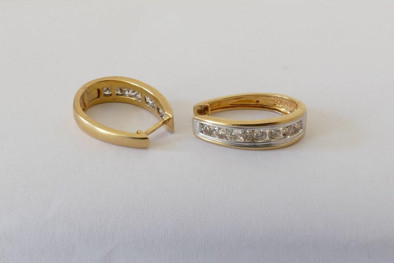 Modern 18 Carat Yellow and White Gold Oval Huggie Style Diamond Earrings For Sale