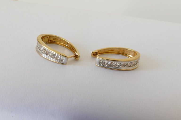 Oval Cut 18 Carat Yellow and White Gold Oval Huggie Style Diamond Earrings For Sale