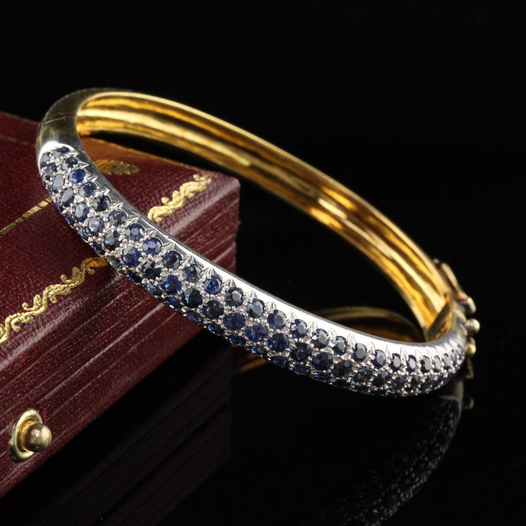 Stunning 18K Yellow Gold and Platinum Bangle  #B0018  Metal: Platinum & 18K Yellow Gold  Weight: 25.2  Sapphire Weight: Approximately 3 CTS  Measurements: 6 in from inside the bangle