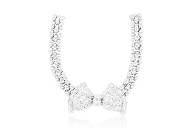 This Antique diamond bow necklace is Italian made in the suburbs of Milan in the 1970s.  Material: 18K White Gold- Approximately 82 grams Approximately 5 Carats of White Diamonds  Color: F-G  Clarity: VS Measurements of Bow: 50 x 30 x 7 mm