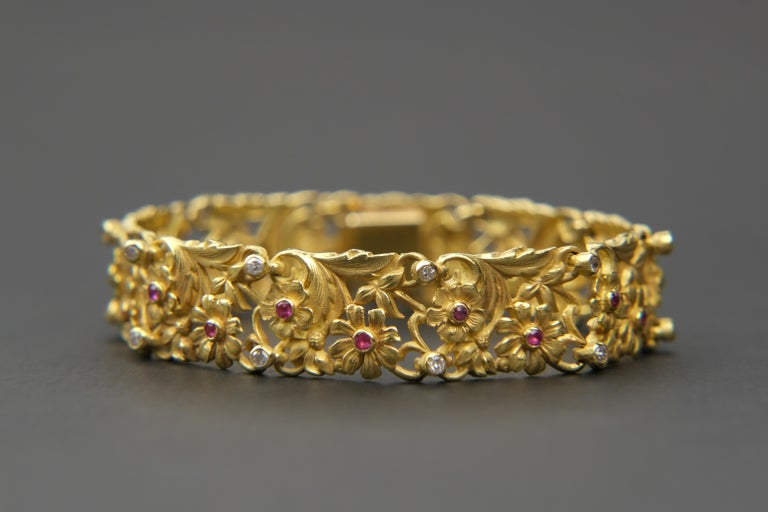 18K Art Nouveau Style Ruby and Diamond Panel Bracelet  These day s a lot of jewelry is chunky and aggressive. Much of it lacks a certain femininity that many like. Some jewelry is actual classified as Brutalist, and ugly name and in most cases, ugly