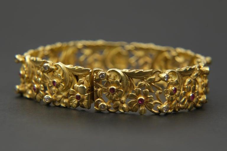 Round Cut 18 Karat Art Nouveau Style Ruby and Diamond Panel Bracelet For Sale