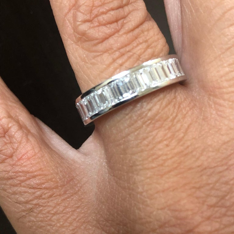 Baguette diamond eternity ring set in 18K white gold. The stones are set in a channel set. The total diamond weight of the ring is 2.20 carats. The color of the stones are F, the clarity is VVS1-VVS2. The ring is a size 6.5.