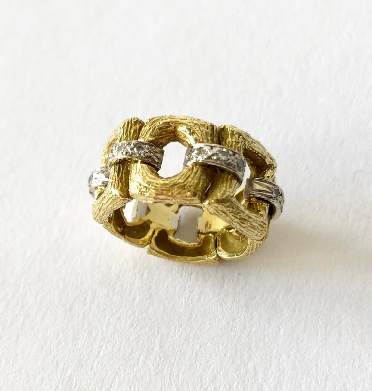 Vintage 18K gold and diamond ring circa, 1960's.  Ring has a bark like texture and features diamond connectors within its design, reminiscent of Cartier or Bulgari.   Ring is a finger size 5.5 to 5.75 and is 3/8