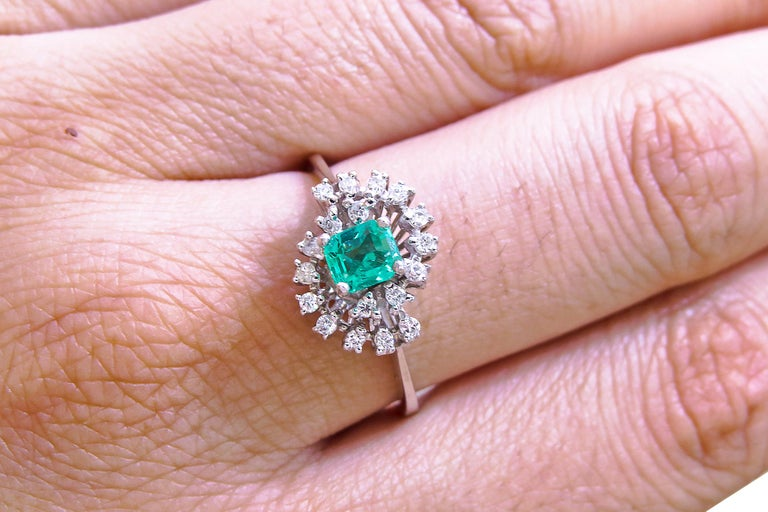 18K White Gold  Weight= 3.6gr  Size= 7  Diamond= 0.36 Ct total  Colombian Emerald= 0.75 Ct total  Year= 2000