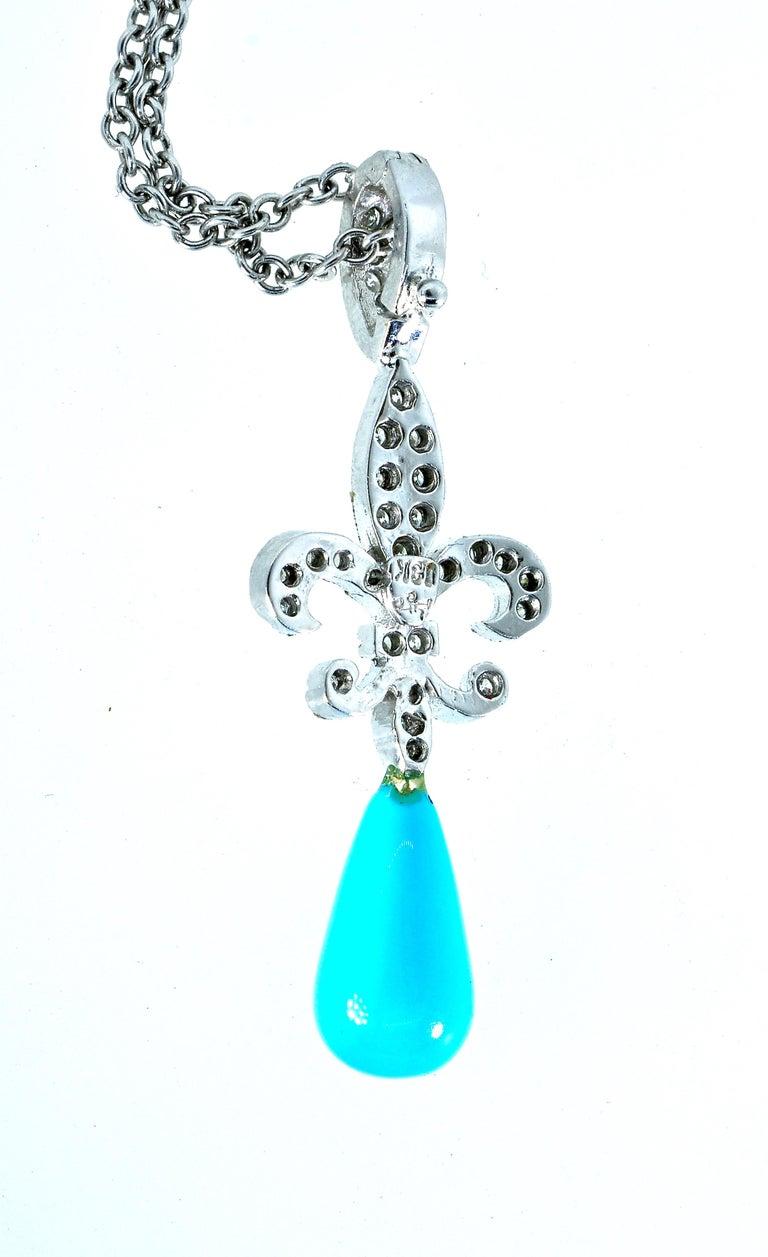 18 Karat Diamond and Turquoise Fleur de Lis Pendant In Excellent Condition For Sale In Aspen, CO