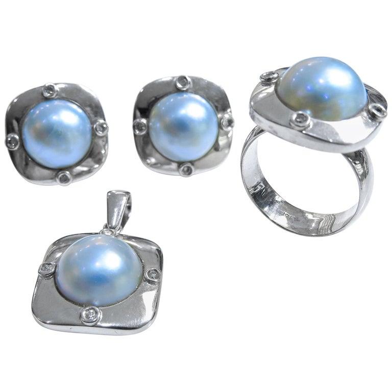 18 Karat Diamond-Pearl Set, Earring, Pendant and Ring For Sale