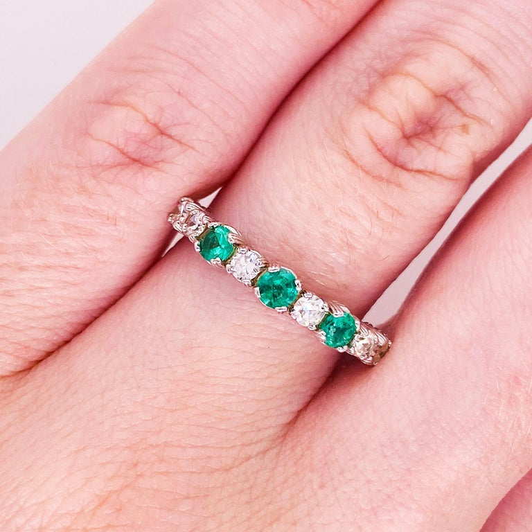 Vibrant emeralds and bright white diamonds have never looked better! This emerald and diamond band has genuine, natural emerald gemstones set in between bright white diamonds. The stones are set in an 18 karat white gold band that is a strong and