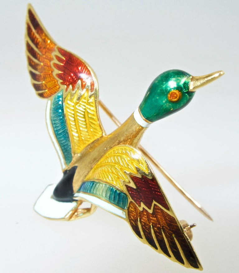 18K and weighing 7.8 grams, with 7 different colors of enamel, both guilloche and opaque, bringing our Mallard duck to life.  He is 2 inches long, and 1.75 inches wide.  In fine condition.