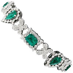 18k Gold 13.43 Carat GIA Colombian Emerald and Butterfly Diamond Link Bracelet