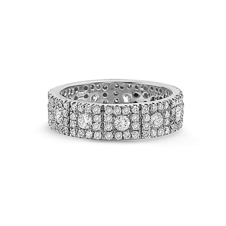 This wedding band features 1.98 carats of diamonds set in 18K white gold. 5.96 grams total weight. Made in Italy.   Viewings available in our NYC showroom by appointment.
