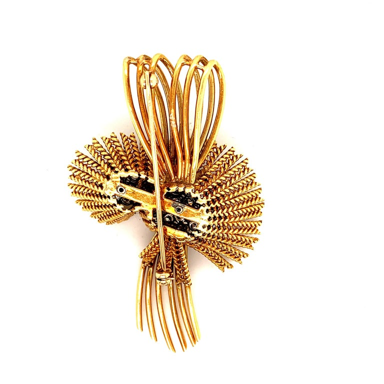 Stunning flower brooch pin, in 18k Gold set with approx. 5 carats of beautiful near colorless Diamonds. This retro pin weighing over 35 grams of Gold captures the glamour of the 1950's.  Viewings available in our NYC wholesale office by