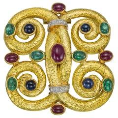 18 Karat Gold Gem-Set Scrolled Quatrefoil Brooch