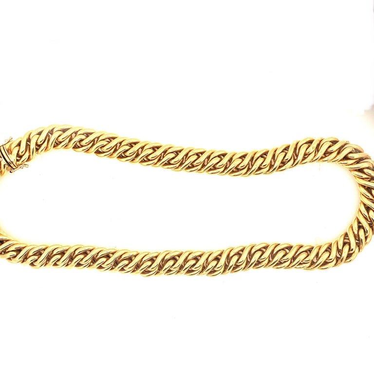 Classic Italian necklace weighing over 74 grams of 18k Gold. Fine artistry makes up this, highly flexible three dimensional, interlocking braided necklace with concealed clasp and safety catch. This charming necklace sits beautifully on the neck