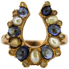18 Karat Gold Ring in Shape of Horseshoe with Pearls and Sapphires