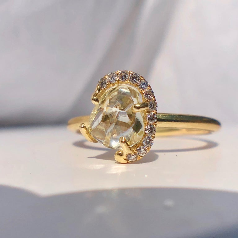 Very Pretty and Wearable Ring From the Wonderful Design Company 'DIAMOND IN THE ROUGH'  An 18 Karat Yellow Gold, Rough Diamond and Diamond Ring by 'Diamond in the Rough'   A ring containing one rough diamond weighing approximately 1.24 carats and 12