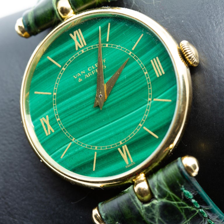 Van Cleef & Arpels 18K Yellow Gold Wristwatch With Malachite Dial. Offered is a authentic 18K gold Van Cleef and Arpels 17 jewel stem wind wristwatch. The watch has a Genuine Crocodile Band 16R Made in USA. The watch is signed on the face and on the