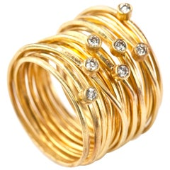 18 Karat Gold Wrapped Wire 'Spaghetti' Ring with Seven 0.03 Carat White Diamonds