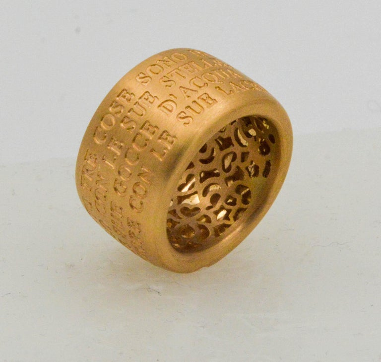 A true novelty with a famous french message and a delicate heart, this ring makes thoughtful gift! Set in 18K yellow gold and inscribed with a powerful quote from the French novelist Gustave Flaubert:  Only three things are infinite  The heavens