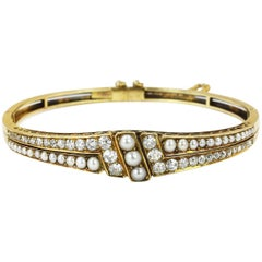 18K Late 19th Century Split Pearl and Diamond Hinged Bangle Bracelet